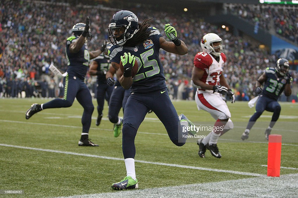 Richard Sherman #25 of the Seattle Seahawks scores a touchdown on a interception return against the Arizona Cardinals at CenturyLink Field on December 9, 2012 in Seattle, Washington.