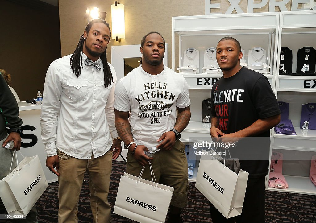 Richard Sherman of the Seattle Seahawks Trent Richardson of the Cleveland Browns, and LaMichael James of the San Francisco 49ers attend EXPRESS 1MX Ultimate Shirt Shop & 'Welcome to New Orleans' Happy Hour at Hyatt French Quarter Hotel on January 31, 2013 in New Orleans, Louisiana.