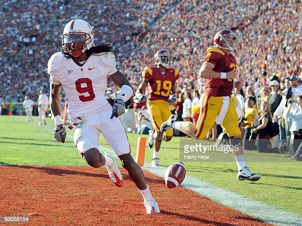 Richard Sherman of the Stanford Cardinal scores a touchdown off an interception thrown by Matt Barkley of the USC Trojans during the second half at...