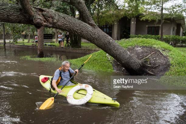 Richard Shieldhouse navigates storm surge flood waters from Hurricane Irma along the St Johns River in the Five Points neighborhood Sept 11 2017 in...
