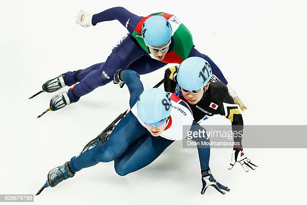 Richard Shoebridge of Great Britain Andrea Cassinelli of Italy and Dan Iwasa of Japan compete in the Mens 1000m Quarter Final during ISU Short Track...