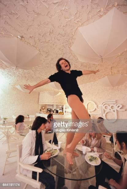 Richard Simmons Standing on a Table