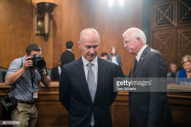 Richard Smith CEO of Equifax center prepares to testify during a Senate Banking Housing and Urban Affairs Committee hearing in Dirksen on the...