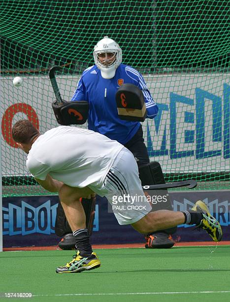 Richard Smith fires a ball at goalkeeper George Pinner of England during a team practice session for the Men's Hockey Champions Trophy tournament in...