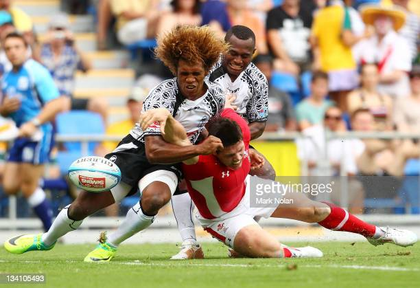 Richard Smith of Wales loses the ball attempting to score as Osea Kolinisau of Fiji tackles during the match between Wales and Fiji on day two of the...