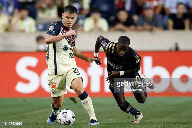 Richard Sánchez of Club America and Jamiro Monteiro of Philadelphia Union challenge for possession during the semifinal second leg match of the...