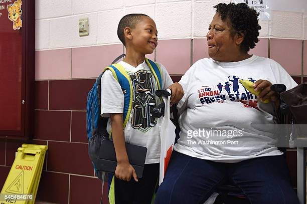 Richard Sowell left smiles at his grandmother Olivia Chase shortly after she picked him up from school Tuesday June 28 2016 at Thomson Elementary...