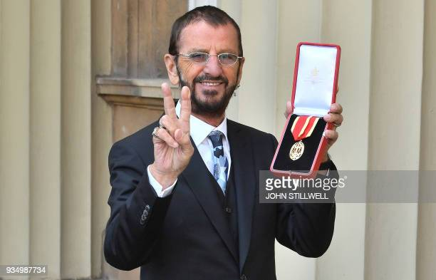 Richard Starkey, better knonwn as Ringo Starr, poses with his medal after being appointed Knight Commander of the Order of the British Empire at an...