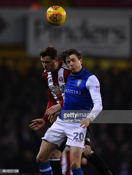 Richard Stearman of Sheffield United and Adam Reach of Sheffield Wednesday in action during the Sky Bet Championship match between Sheffield United...