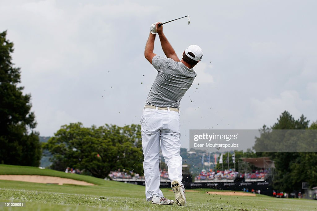 Richard Sterne of South Africa hits his approach shot on the 18th hole during the Final Round of the Joburg Open at Royal Johannesburg and Kensington Golf Club on February10, 2013 in Johannesburg, South Africa.