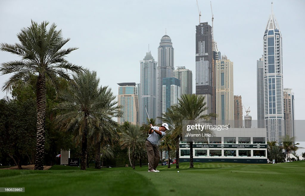 Richard Sterne of South Africa plays his second shot into the 16th green during the third round of the Omega Dubai Desert Classic at Emirates Golf Club on February 2, 2013 in Dubai, United Arab Emirates.