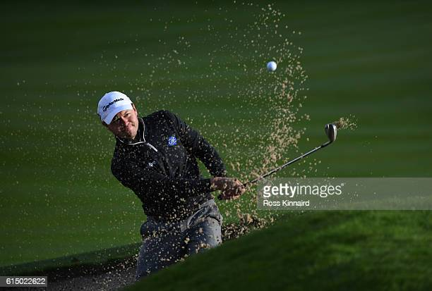 Richard Sterne of South Africa plays his third shot on the 18th hole uring the fourth round of the British Masters at The Grove on October 16 2016 in...