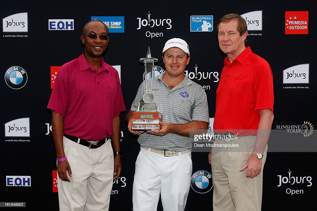 Richard Sterne (C) of South Africa poses with the trophy and Johannesburg Mayor, Parks Tau (L) and European Tour Chief Executive, George O'Grady (R) after winning the Joburg Open at Royal Johannesburg and Kensington Golf Club on February10, 2013 in Johannesburg, South Africa.