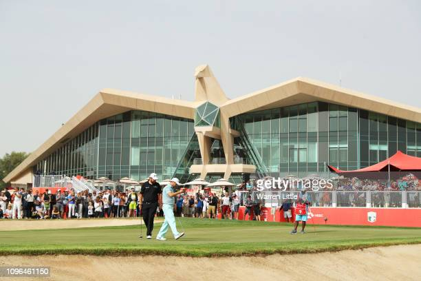 Richard Sterne of South Africa reacts on the ninth green as Shane Lowry of Ireland looks on during Day Four of the Abu Dhabi HSBC Golf Championship...
