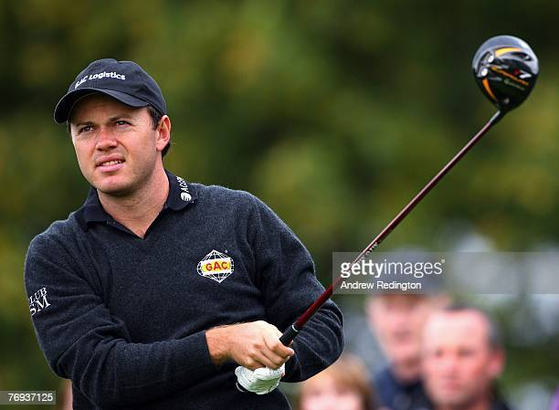 Richard Sterne of South Africa watches his tee-shot on the 16th hole during the second round of the Quinn Direct British Masters on the Brabazon...
