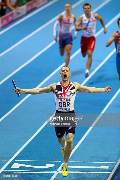 Richard Strachan of Great Britain and Northern Ireland crosses the line to win gold competes in the Men's 4x400m Relay Final during day three of...