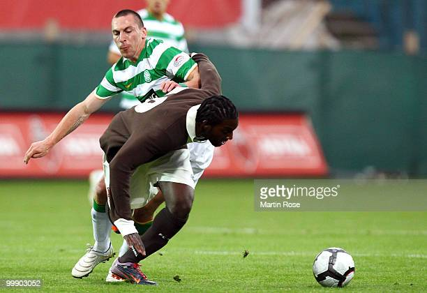 Richard Sukuta Pasu of St Pauli and Scott Brown of Celtic battle for the ball during the friendly match between FC St Pauli and Celtic at the...