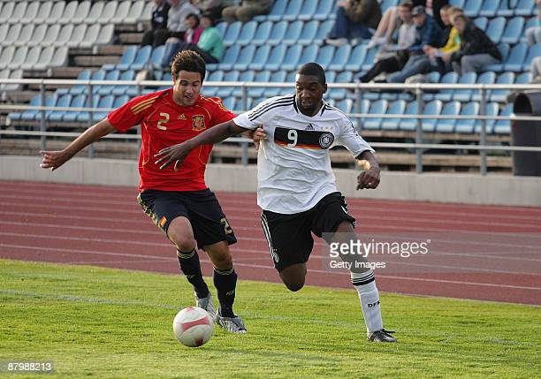 Richard SukutaPasu of Germany battles for the ball with Mario Gaspar during the U19 Euro Qualifier match between Spain and Germany at the A Le Coq...