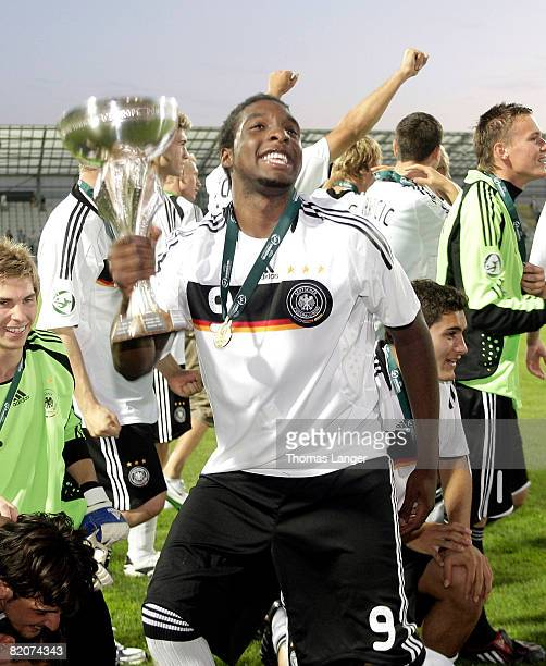 Richard Sukuta-Pasu of Germany celebrates with the cup after the U19 European Championship final match between Germany and Italy on July 26, 2008 in...