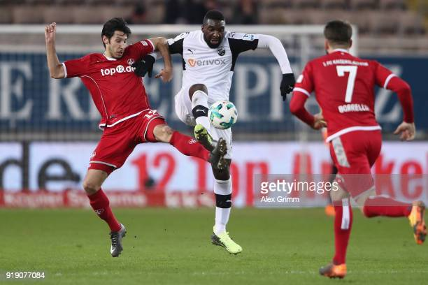 Richard SukutaPasu of Sandhausen is challenged by Marcel Correia and Brandon Borrello of Kaiserslautern during the Second Bundesliga match between 1...