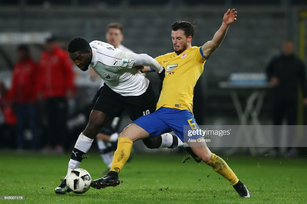 Richard Sukuta-Pasu (L) of Sandhausen is challenged by Quirin Moll of Braunschweig during the Second Bundesliga match between SV Sandhausen and Eintracht Braunschweig at Hardtwaldstadion on February 24, 2017 in Sandhausen, Germany.