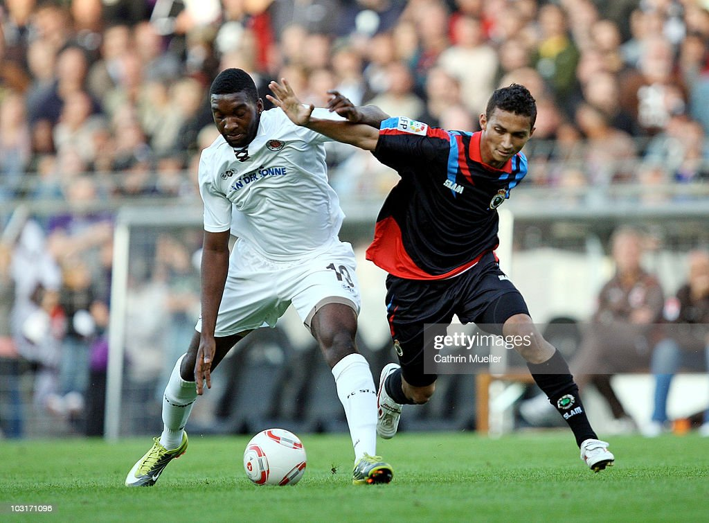 Richard Sukuta-Pasu of St. Pauli battles for the ball with Danilo of Santander during the pre-season friendly match between FC St. Pauli and Racing Santander at Millerntor Stadium on July 30, 2010 in Hamburg, Germany.