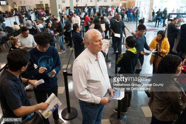 Richard Taylor of Huntington Beach patiently waits in line to get his driver's license renewed at the crowded new DMV office in Stanton Saturday...