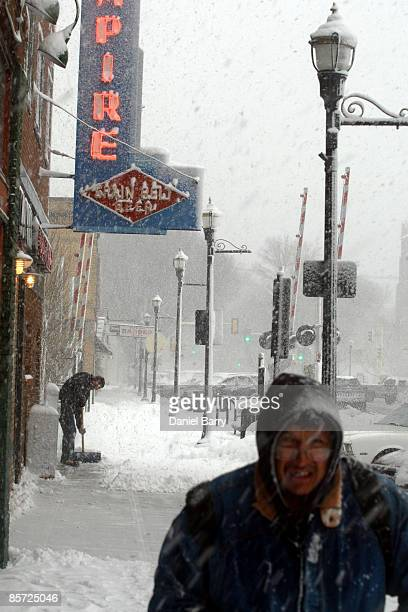 Richard Thelen shovels the sidewalk in front of the Empire Tavern as snow falls March 302009 in Fargo North Dakota Forecasters were expecting 14...