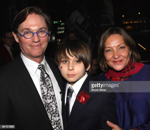 Richard Thomas son Montana James Thomas and wife Georgiana Thomas pose at the opening night after party for Race at the Redeye Grill on December 6...
