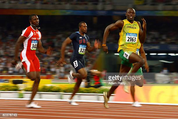 Richard Thompson of Trinidad and Tobago, Darvis Patton of the United States and Usain Bolt of Jamaica compete in the Men's 100m Final at the National...