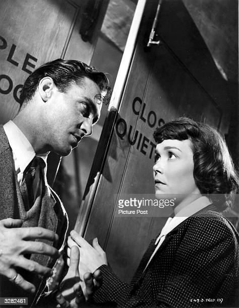 Richard Todd appears in a dramatic scene from the film 'Stage Fright' with American leading lady Jane Wyman The film was directed by Alfred Hitchcock...