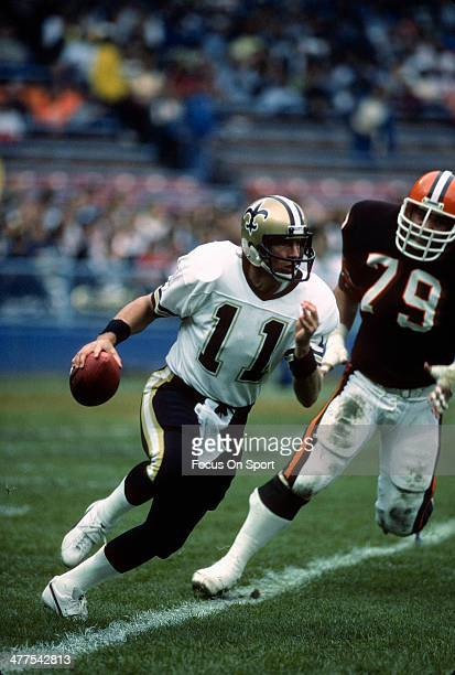 Richard Todd of the New Orleans Saints scrambles away from the pressure of Bob Golic of the Cleveland Browns during an NFL football game October 28...