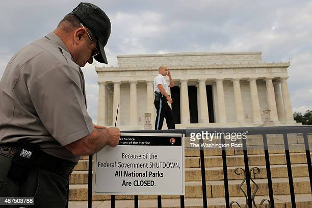 Richard Trott of the National Park Service puts up a sign announcing the closure of the Lincoln Memorial due to the government shutdown on Tuesday...
