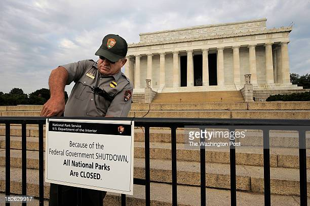 Richard Trott of the National Park Service works on a sign announcing the closure of the Lincoln Memorial due to the government shutdown on Tuesday...