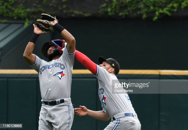 Richard Urena and Brandon Drury of the Toronto Blue Jays collide as Urena makes a catch against the Chicago White Sox during the third inning at...