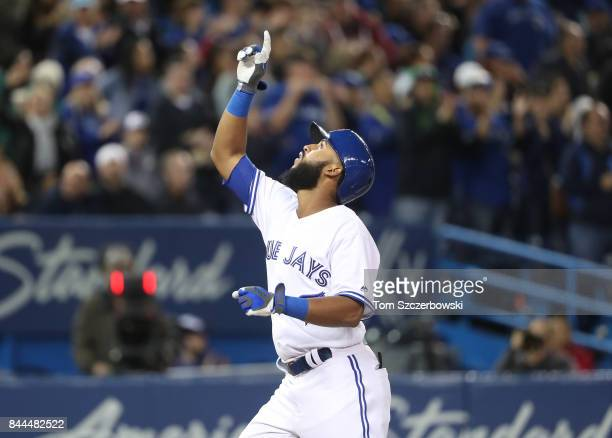 Richard Urena of the Toronto Blue Jays celebrates after hitting a solo home run in the eighth inning during MLB game action against the Detroit...