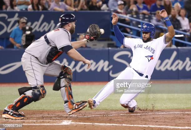 Richard Urena of the Toronto Blue Jays is forced out at home plate with the bases loaded as Brian McCann of the Houston Astros records the putout in...
