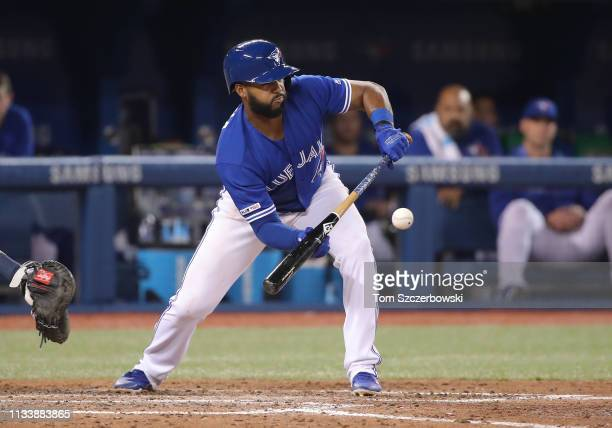Richard Urena of the Toronto Blue Jays lays down a sacrifice bunt successfully in the seventh inning during MLB game action against the Detroit...