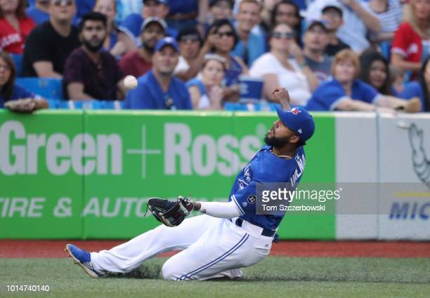 Richard Urena of the Toronto Blue Jays makes a sliding catch in foul territory in the second inning during MLB game action against the Tampa Bay Rays...