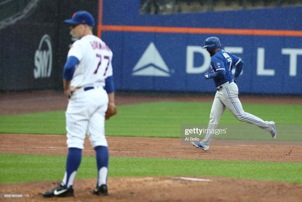 Richard Urena #7 of the Toronto Blue Jays rounds the bases after hitting a three run home run against Buddy Baumann #77 of the New York Mets in the ninth inning during their game at Citi Field on May 16, 2018 in New York City.