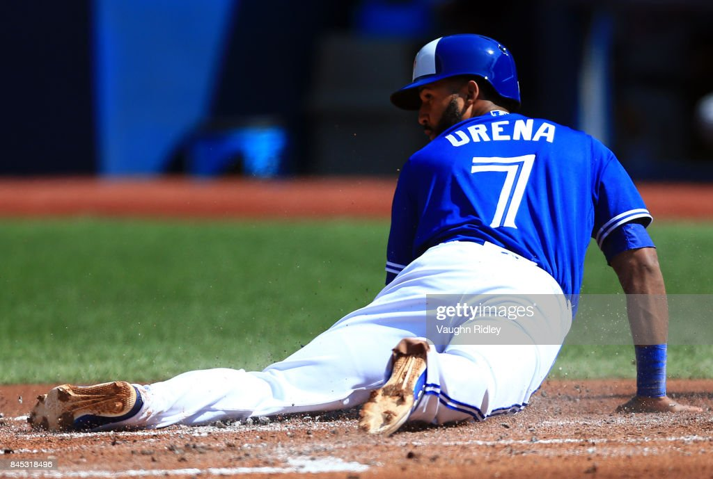 Richard Urena #7 of the Toronto Blue Jays scores a run in the first inning during MLB game action against the Detroit Tigers at Rogers Centre on September 10, 2017 in Toronto, Canada.
