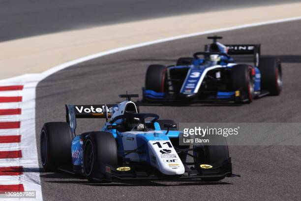Richard Verschoor of Netherlands and MP Motorsport leads Guanyu Zhou of China and UNI-Virtuosi Racing during the Feature Race of Round 1:Sakhir of...