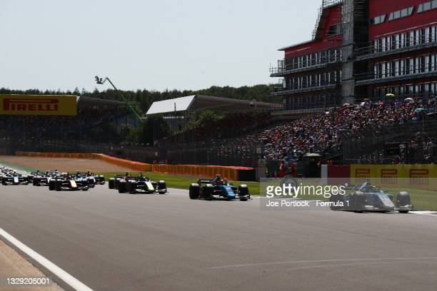 Richard Verschoor of Netherlands and MP Motorsport leads Marcus Armstrong of New Zealand and DAMS at the start during sprint race 2 of Round...