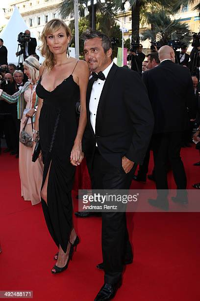 Richard Virenque and a guest attend the Two Days One Night premiere during the 67th Annual Cannes Film Festival on May 20 2014 in Cannes France