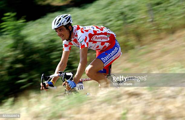 Richard Virenque takes a descent sporting the polka dot jersey as 'King of the Mountains' during stage 15 from Valreas to VillarddeLans of the 2004...