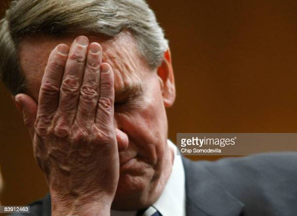 Richard Wagoner Jr chairman and CEO of General Motors wipes his eyes as he awaits the start of a Senate hearing on the auto industry December 4 2008...