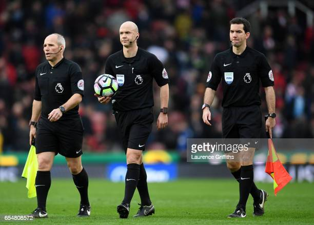Richard West assistant referee Anthony Taylor referee and Adam Nunn assistant referee walk out prior to the Premier League match between Stoke City...