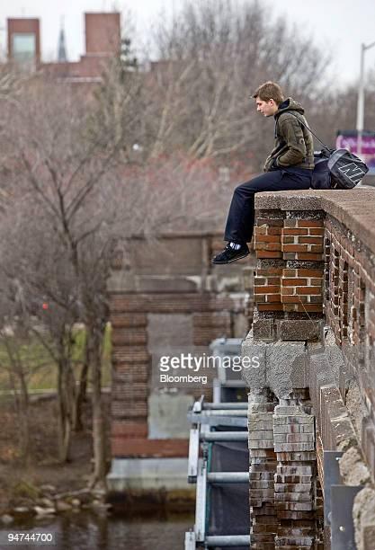Richard White a Harvard University graduate student sits on the Eliot Street bridge near the school's campus in Cambridge Massachusetts US on Tuesday...