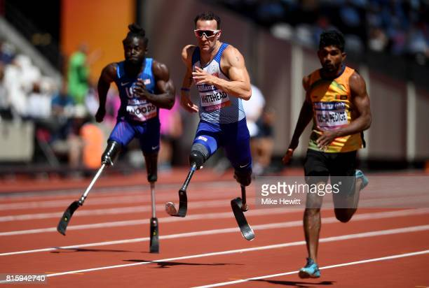Richard Whitehead of Great Britain Regas Woods Sr of the USA and Anil Prasanna Jayalath Yodha Pedige of Sri Lanka compete in the Men's 100m T42 Round...