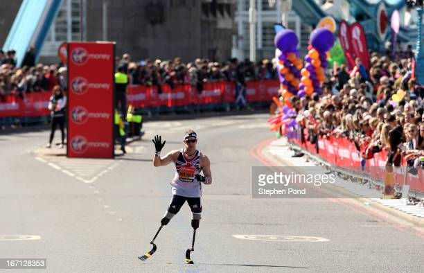 Richard Whitehead of Great Britain seen after crossing Tower Bridge during the Virgin London Marathon on April 21 2013 in London England